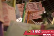 Banknote collector excited about new era of currency design that Thai king's coronation will bring