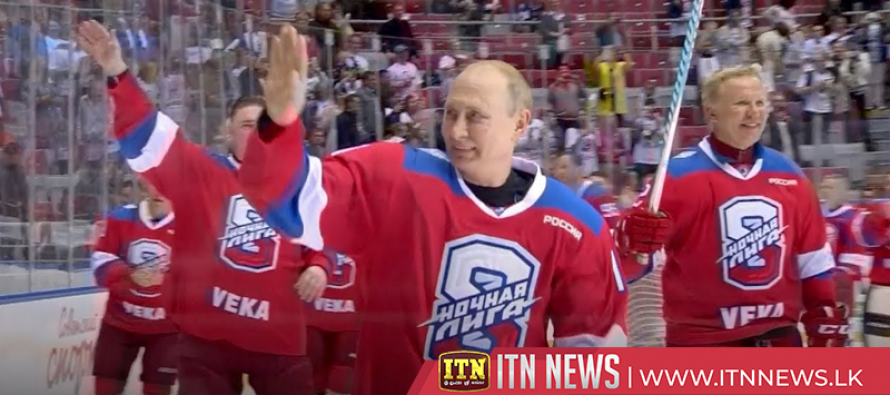 Putin takes a tumble after scoring eight goals in ice hockey match