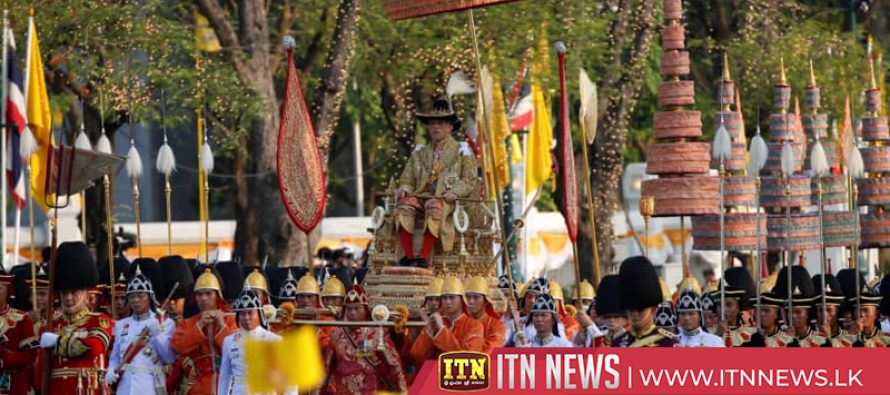 Newly-crowned Thai king carried through Bangkok in royal procession