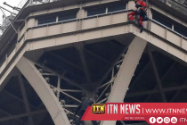 Firefighters try to rescue man who climbed Eiffel Tower