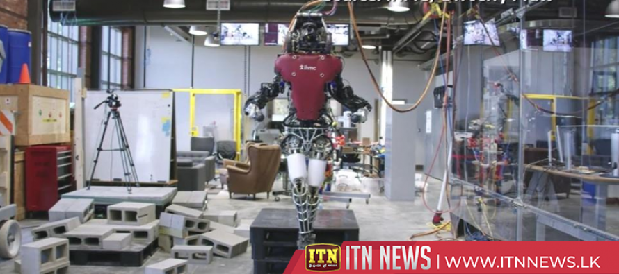 Humanoid robot walks tightrope-like walkway