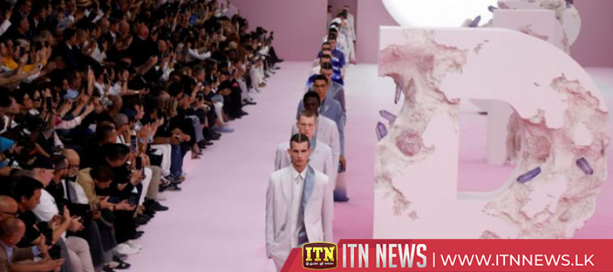 Dior men trek in suits, sashes and shorts on a dreamy wasteland