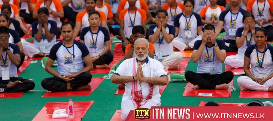 India's Modi leads tens of thousands to do yoga