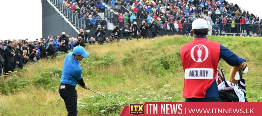 Holmes leads Open as McIlroy endures nightmare and Woods struggles