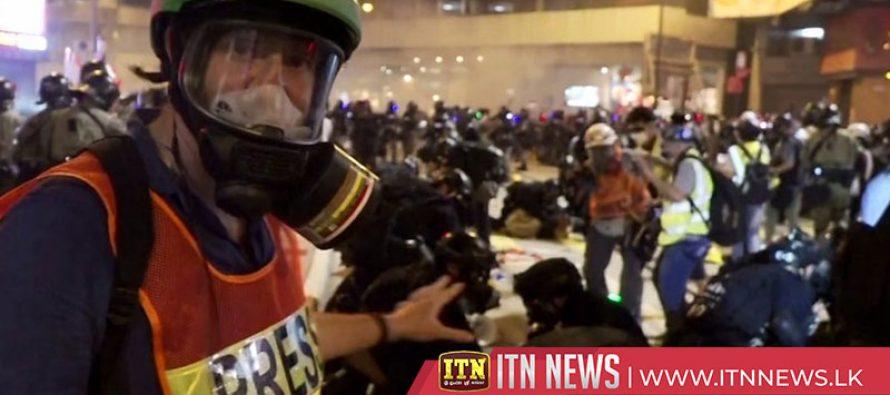 Police fire tear gas near China's liaison office
