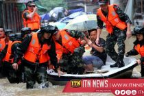 Rescuers evacuate flood-trapped people in central China city
