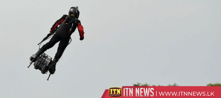 Flying soldier steals the show at Bastille Day parade