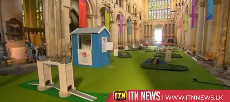Pray or play? Crazy golf course in British cathedral