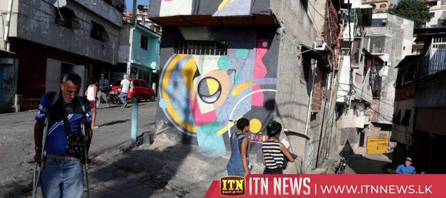 Artists use street murals to change image of violent Caracas slum