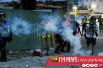 Hong Kong police fire tear gas as protesters near Yuen Long MTR station