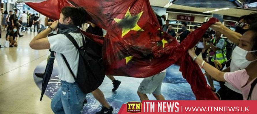 China flag desecrated as fresh unrest erupts