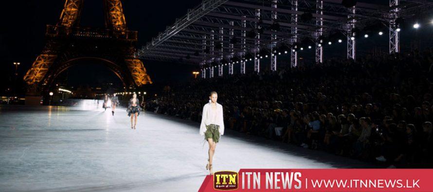 YSL models walk runway for Paris Fashion Week against backdrop of Eiffel Tower