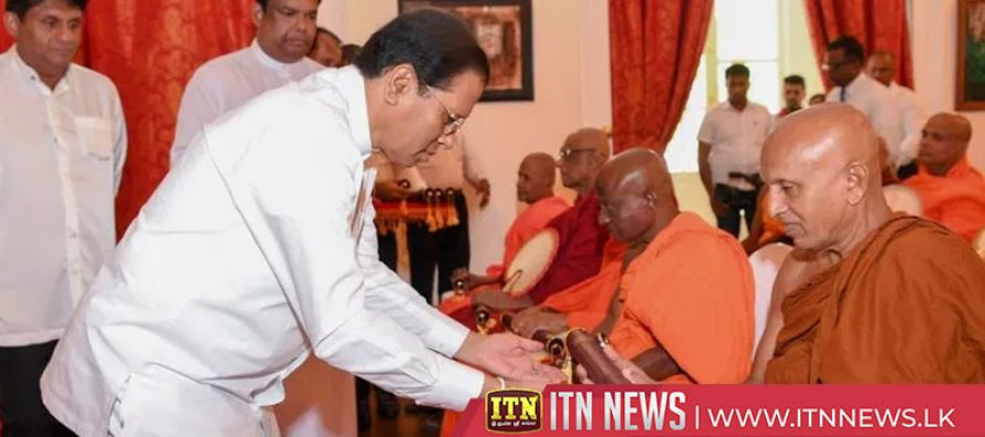 The President hands over title deeds for 75 sacred premises