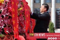 Chinese Xi's presenting flowers to national heroes on Martyrs' Day