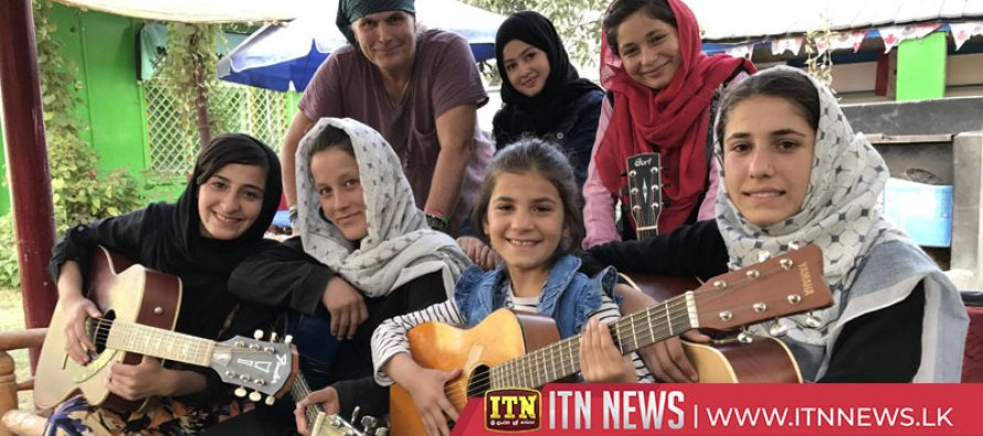 Afghan teenage singer teaches Kabul street children to take up music