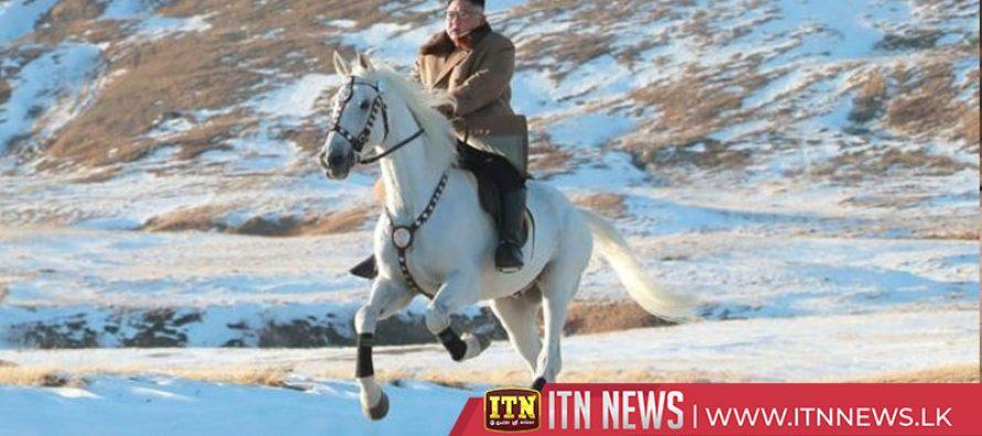 North Korean leader rides horse up sacred mountain