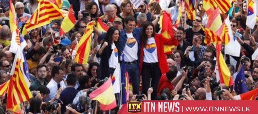 Catalan demonstrators throw rubbish bags near Spanish government headquarters