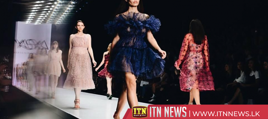 Models strut on catwalk in art museum for Moscow Fashion Week