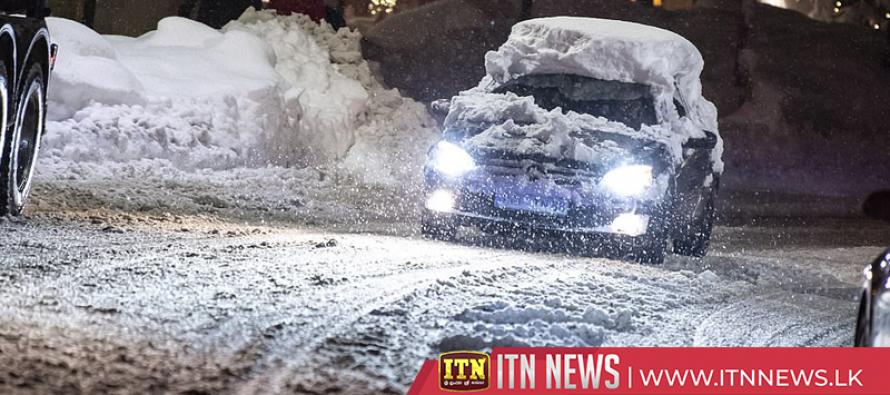 Vehicle drives through heavy Colorado snowfall