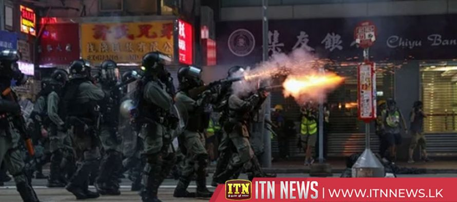 Hong Kong protesters set barricade on fire after volleys of tear gas fired