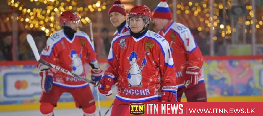 Russia's Putin plays hockey in Red Square alongside defence minister