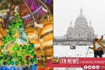 Christmas sparkle in Paris' shopping quarter dimmed by strikes