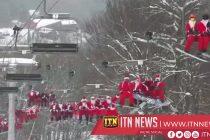 Hundreds of skiing Santas bring holiday cheer to Maine