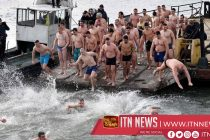Russians take a dip in icy water to mark Orthodox Epiphany