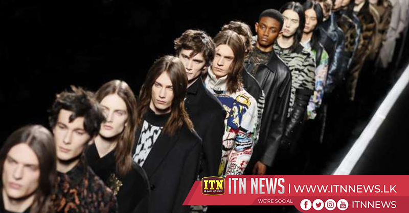 Dior rolls out sashes and suits for men – on a conveyor belt