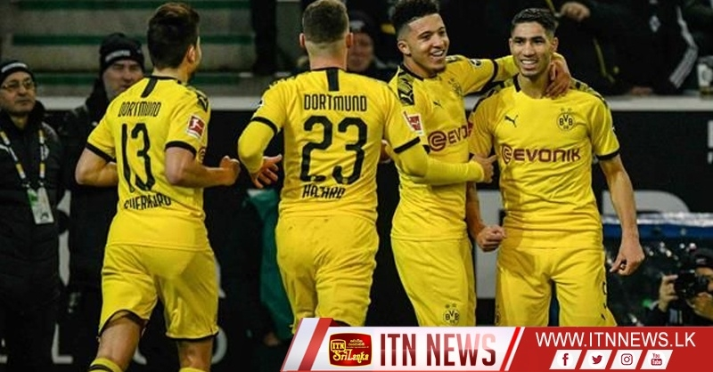 Dortmund move into second spot with 2-1 win at Gladbach