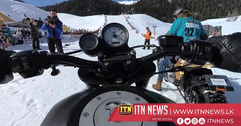 Harley-Davidsons race, slide and crash on snowy slope