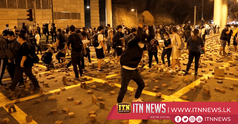 Handful of protesters surrender, many more trapped inside besieged Hong Kong campus