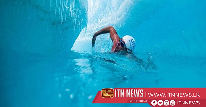 Swimmer raises awareness on climate change in freezing Antarctic waters