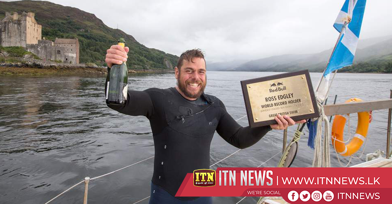 Edgley breaks longest staged sea swim world record