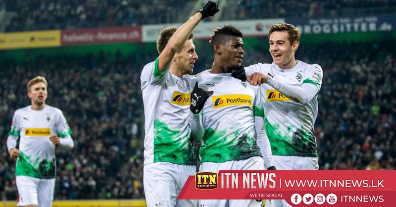 Gladbach stay top thanks to Embolo double