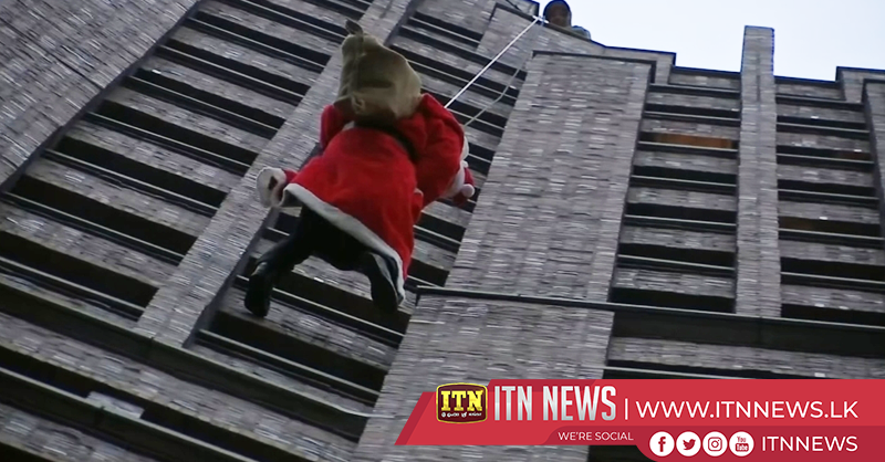 Santa rappels down skyscraper delivering gifts to Berlin children