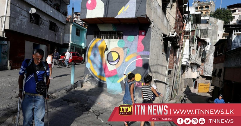Artists use street murals to change image of violent Caracas slum