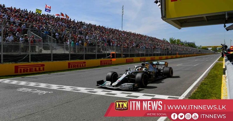 Hamilton claims Canadian GP win after controversial Vettel penalty