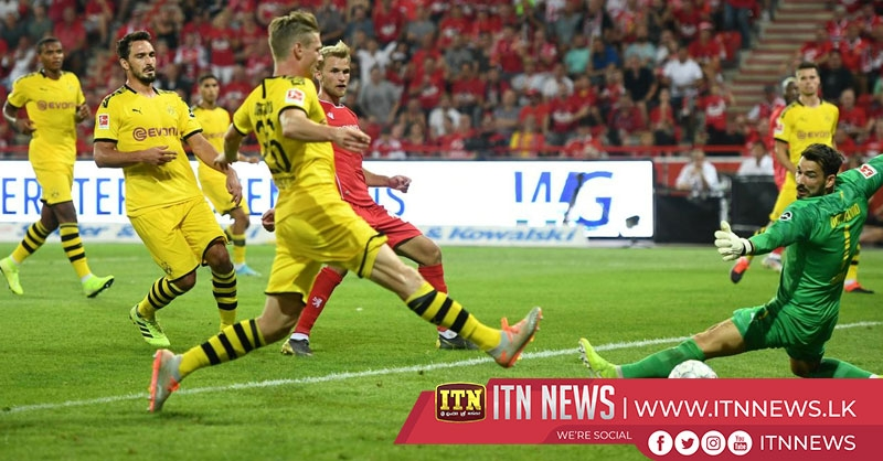 Union shock Dortmund 3-1 for first Bundesliga win