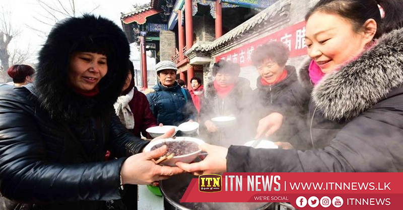 Folk activities held across China to celebrate Laba Festival