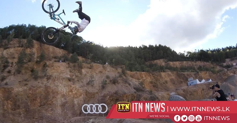 Dramatic high-flying mountain bike firsts